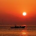 写真: 昇る朝日のように